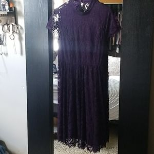 Pretty lacy purple dress with open back